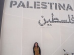 Nura infront of the Palestinian Pavilion