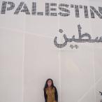 Nura infront of the Palestinian Pavilion