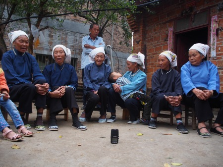 Recording a group of Zhuang women, singing traditional songs